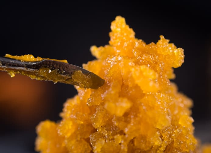 Cannabis concentrate live resin (extracted from medical marijuana) with a dabbing tool